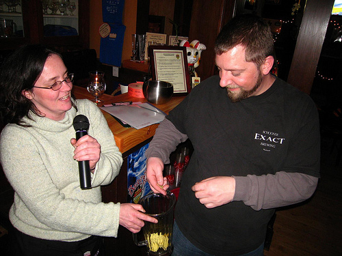 Lorraine (Bev Place Beer Goddess) helps Marcus pick the winner of the bike, just one of the prizes they raffled off last night.